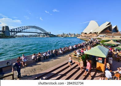 Sydney, Australia - January 23, 2015: People relaxing and dining along the Circular Quay in a sunny afternoon in Sydney, Australia.