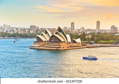 Sydney, Australia - January 23 : View of the Sydney Harbour with some ferries passing by Sydney Opera House on January 23, 2015 in Sydney, Australia.