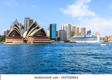 Sydney, Australia - January 4th 2014: Cruise ship moored in Sydney Harbour by the Opera House. The Central Business District is behind.