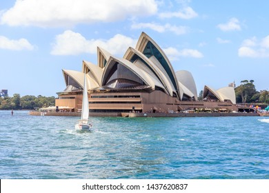 Sydney, Australia - January 4th2014: A yacht sails past the Opera House in the harbour. The building is an iconic piece of architecture.