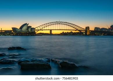 Sydney, Australia - July 03, 2016: Panoramic view of Sydney Opera House and Sydney Harbour Bridge along Sydney Harbour at dusk