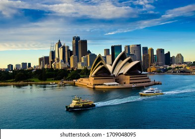 Sydney, Australia - July 10, 2018: An evening view of the famous Sydney Opera House and skyscrapers of Sydney.