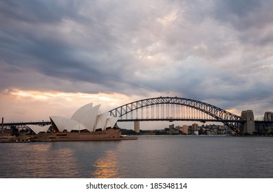 Sydney, Australia - July 11, 2010 : Dramatic sky and the Sydney Opera House at dusk. Sydney skyline taken from Mrs. Macquarie's Point.