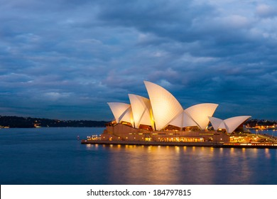 Sydney, Australia - July 12, 2010 : View of the Sydney Opera House with nice clouds, sky background at blue night.