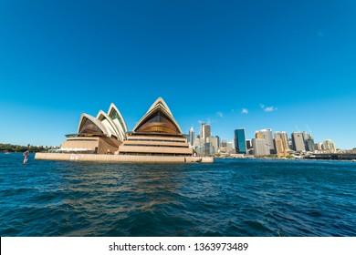 Sydney, Australia - July, 23, 2016: View of Circular Quay with Sydney Opera House and Sydney CBD on sunny day