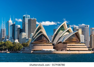 Sydney, Australia - July 23, 2016: Beautiful view of iconic Sydney's landmark Sydney Opera House with skyscrapers and office buildings of Sydney Central Business District on the background
