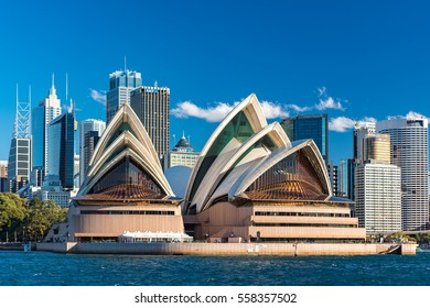 Sydney, Australia - July 23, 2016: View of iconic Sydney's landmark Sydney Opera House with skyscrapers and office buildings of Sydney Central Business District on the background