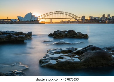 Sydney, Australia - July 28, 2016: View of the Opera House and City Sydney Tower in the beautiful sunset times with blue sky taken by long exposure technique, the most iconic landmarks in Sydney.