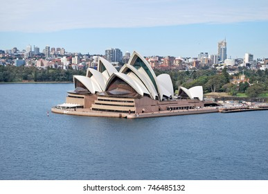 Sydney, Australia - July 29, 2014: Panoramic landscape view of Sydney Opera House and downtown right after sunrise in Sydney Harbour.
