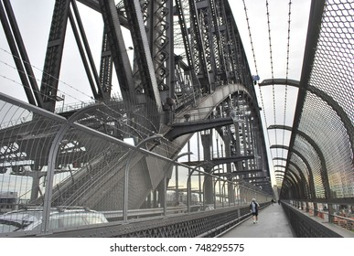 Sydney, Australia - July 29, 2016: Morning traffic and people walking footbridge at Sydney Harbour Bridge.