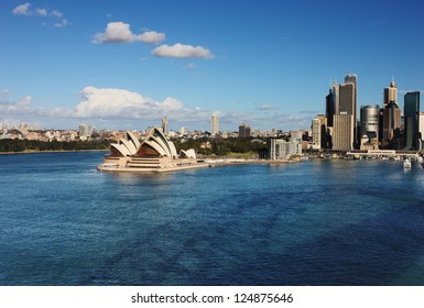 SYDNEY, AUSTRALIA - JULY 6 : A Skyline View of Sydney showing the Sydney Opera House and ferry activity taken on July 6, 2012. A multi-venue arts center designed by Danish architect Jorn Utzon.