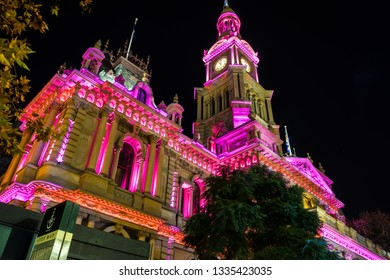 Sydney, Australia - Jun 06, 2015: Illuminated facade of the Town Hall at the annual Vivid Sydney festival of light, music and ideas