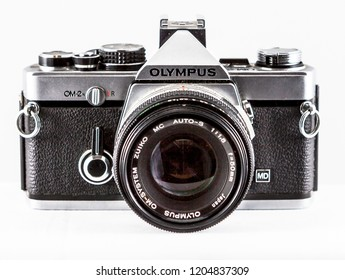 Sydney, Australia - June 04, 2018: An old Olympus OM2 SLR film camera with a 50mm lens on a white background.