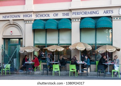 Sydney, Australia - June 09, 2012: People at outdoor cafe near Newtown HIgh school of the Performing Arts
