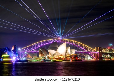 Sydney, Australia - June 09, 2018: Sydney Harbour Bridge and Opera House at night as part of the Vivid Sydney festival.