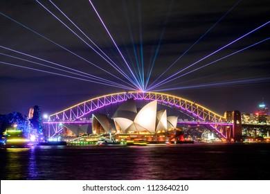 Sydney, Australia - June 09, 2018: Sydney Harbour Bridge and Opera House at night as part of the Vivid Sydney festival.