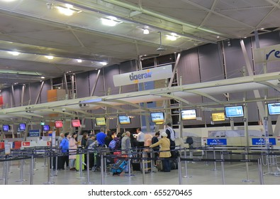 SYDNEY AUSTRALIA - JUNE 1, 2017: Unidentified people check in at Tigerair counter Sydney Airport.