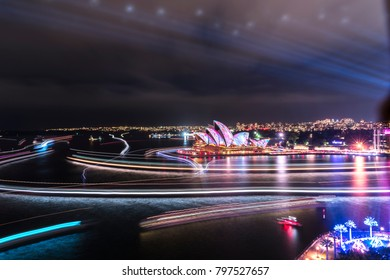 Sydney, Australia - June 13, 2017: Long exposure photo of Sydney Harbour and Opera House at night as part of the Vivid Sydney festival.