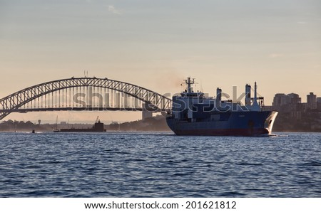 SYDNEY, AUSTRALIA - JUNE 22, 2014: A cargo ship sails out of Sydney Harbour. Freighters are rare in the harbour, with nearby Port Botany preferred,