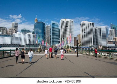 Sydney, Australia- June 25 2017: People enjoying walk through Darling Harbour