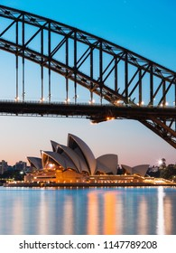 Sydney, Australia - June 30, 2018: Close up view of Sydney Opera House and Sydney Harbour Bridge at dawn.