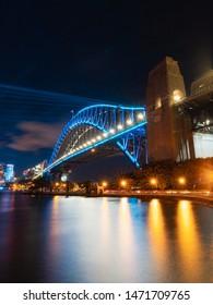 Sydney, Australia - June 5, 2019: Sydney Harbour Bridge with blue light during Vivid Sydney.