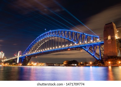Sydney, Australia - June 5, 2019: Sydney Harbour Bridge with blue light during Vivid Sydney.