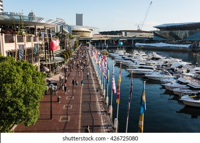 Sydney, Australia - Mar 26, 2016: Aerial view of Darling Harbour, Cockle bay wharf and Pyrmont. Tourists and locals enjoying a sunny evening in Sydney
