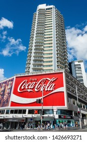 Sydney, Australia - March 10, 2017. The Coca-Cola Billboard in Kings Cross, Sydney, with commercial properties and people, at daytime.