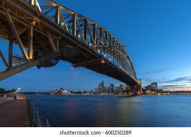 SYDNEY, AUSTRALIA - March 12, 2017: Sunset at Sydney Harbour Bridge and Opera House illuminated with colourful light, Over 10 millions tourists visit Sydney every year