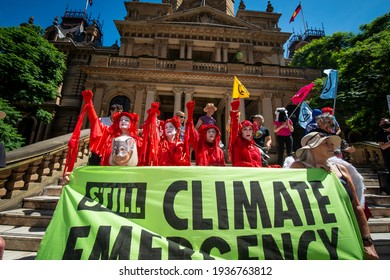 Sydney, Australia - March 13, 2021 - Extinction Rebellion Sydney march through the CBD to protest in front of Sydney's Town Hall.