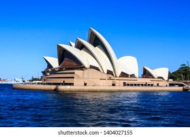 Sydney, Australia - March 13th 2013: View of the Opera House in Sydney Harbor. The Central Business District is in the background.