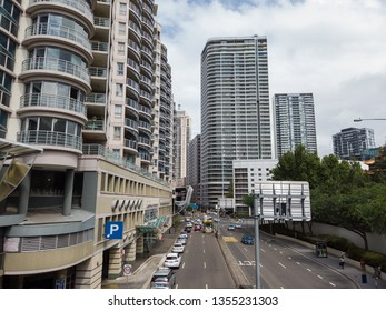 Sydney, Australia - March 15, 2019: Car traffic at Harbour St with skyscrapers buildings.
