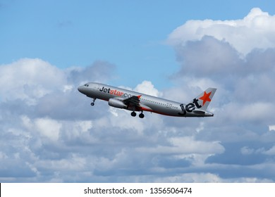 Sydney, Australia - March 20, 2019: Jetstar Airbus A320 takes off to a cloudy sky. Registration VH-VQA