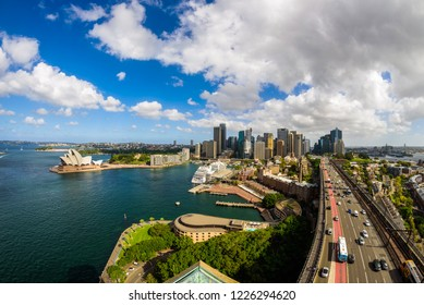 Sydney, Australia - March 2017. View of the CBD on a sunny summer day with partly cloudy blue sky, from the Pylon Lookout on top of the Harbour Bridge. Wide angle, Fisheye lens