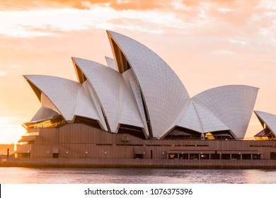 SYDNEY, AUSTRALIA - MARCH 25, 2018: Sydney Opera House close-up view with sunrise sky on the background.
