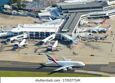 Sydney / Australia - March 25 2018: Aerial view of Sydney Kingsford Smith International Airport with multiple widebody long haul aircraft from airline carriers. Busy terminal concourse.