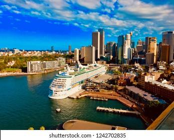 Sydney, Australia March 27, 2018 An aerial shot of Sydney Harbor with a Royal Caribbean cruise ship docked near city center.