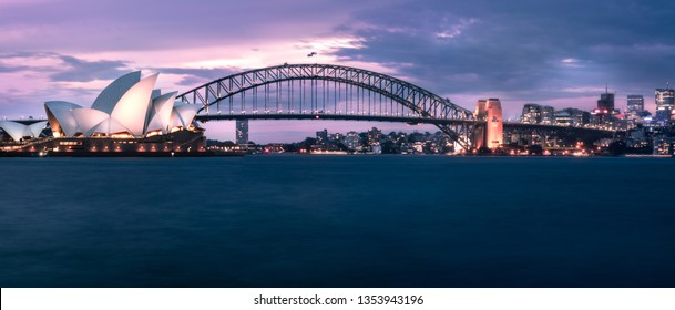 Sydney, Australia -March 29, 2019: Waterfront View in the evening with Opera House, Harbour Bridge and North Sydney in Australia.