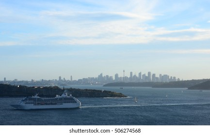 Sydney, Australia - March 30, 2013. Cruise ship navigating into the South Pacific Ocean. Harbour and CBD city view from North Head.