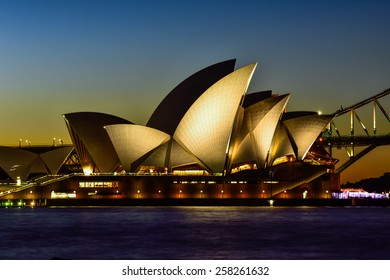 SYDNEY AUSTRALIA - March 6, 2015 : View of sunset at Sydney Opera House on March 6 in Sydney, Australia. Over 10 millions tourists visit Sydney every year