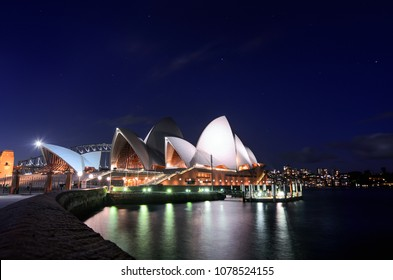 SYDNEY, AUSTRALIA - MARCH 7, 2018 - Southern constellations twinkle in a starry night sky over the iconic Sydney Opera House