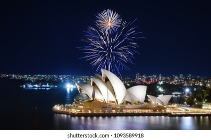 SYDNEY, AUSTRALIA - MARCH 8, 2018 - Blue and white fireworks explode in the sky over the Sydney Opera House in a dazzling spectacle of lights