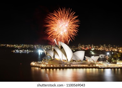 SYDNEY, AUSTRALIA - MARCH 8, 2018 - Orange explosion of fireworks over the Sydney Opera House with reflection in the harbor