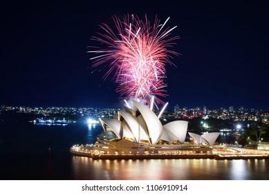 SYDNEY, AUSTRALIA - MARCH 8, 2018 - A huge burst of pink fireworks light up the harbor around the Sydney Opera House