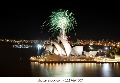 SYDNEY, AUSTRALIA - MARCH 8, 2018 - A shower of green fireworks spouts over the Sydney Opera House during a pyrotechnic show