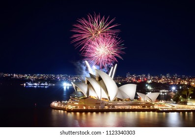 SYDNEY, AUSTRALIA - MARCH 8, 2018 - Bright bursts of fireworks explode over the Sydney Opera House in a beautiful display at night