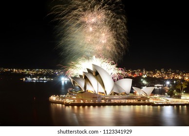 SYDNEY, AUSTRALIA - MARCH 8, 2018 - A huge fireworks show finale rains down over the Sydney Opera House against the backdrop of the city