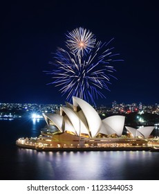 SYDNEY, AUSTRALIA - MARCH 8, 2018 - Sydney Harbor glows with blue reflections under a spectacular fireworks show over the Opera House