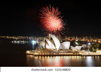 SYDNEY, AUSTRALIA - MARCH 8, 2018 - Fiery red fireworks light up the Sydney Opera House and Harbor in a brilliant display